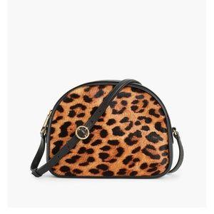 Half moon calf hair leopard cross body bag